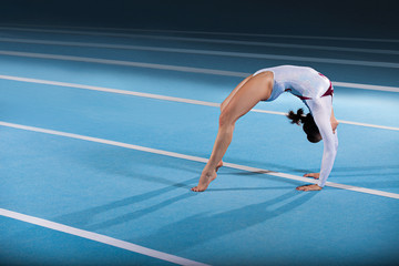 portrait of young gymnasts competing in the stadium