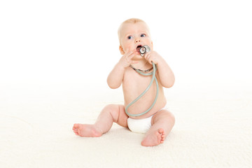 Baby with stethoscope.