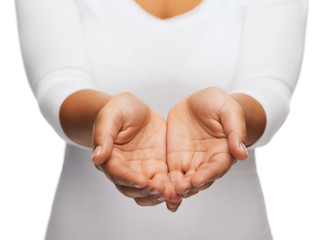 womans cupped hands showing something