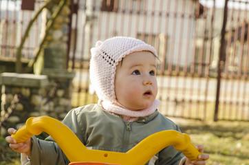 Baby girl riding her bike