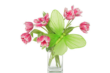 Big green paper butterfly and pink tulips in glass vase