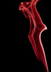 red smoke on black background studio