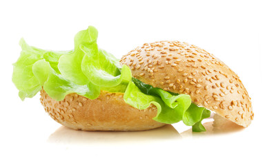 Buns with sesame seeds with salad on a white background