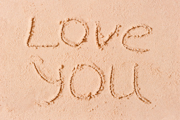 I love you written on wet sand on the beach