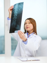 concentrated doctor looking at x-ray