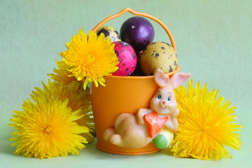 Easter Card : bunny , eggs and flowers - green background