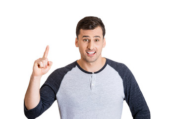 Man who just came up with an idea, pointing finger up