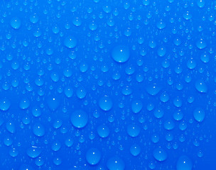 Drops of water on a blue background. Macro