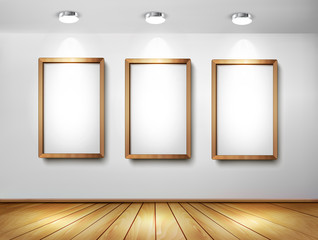 Empty wooden frames on wall with spotlights and wooden floor. Ve