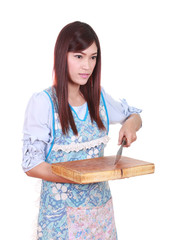 female chef holding the chopping block and knife