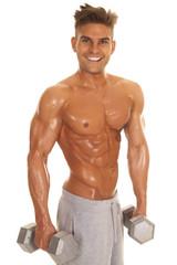man no shirt shiny weights stand smile