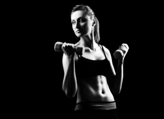 Silhouette of a fitness young woman on black background