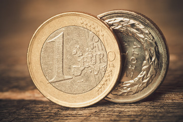 Euro coins on wooden table