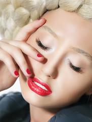 Woman's Face Close-up Portrait. Red Lipstick and Fingernails