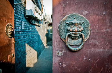 Fotorolgordijn Beijing brass lion head door knockers in hutong area in Beijing, China
