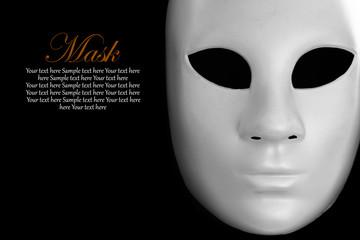White mask on black background