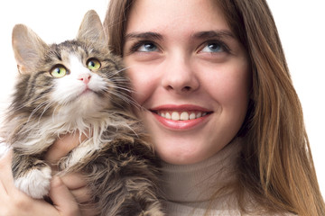 beautiful girl with fluffy kitten in her arms