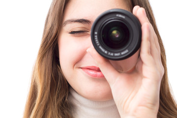 portrait of beautiful girl with the lens near the eye