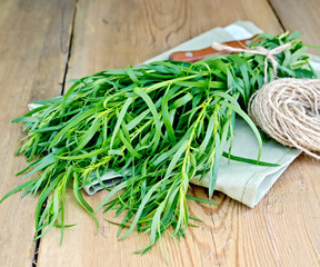 Tarragon with a knife and twine on the board