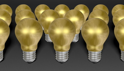 Group of golden light bulbs on grey background