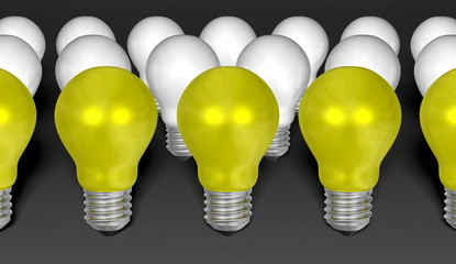 Rows of yellow and white light bulbs on grey background