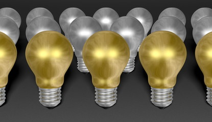 Rows of golden and silver light bulbs on grey background