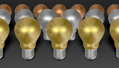 Rows of golden, silver and bronze light bulbs on grey background