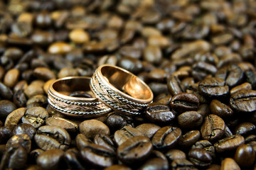 Wedding rings on coffee beans