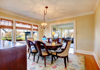 Dard brown and yellow dining room