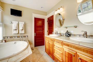 Modern bathroom with whirpool and tv