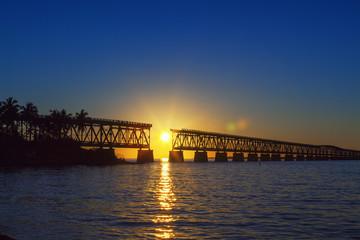 colorful sunset with broken bridge