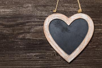 Kreide Tafel Herz auf Holzwand