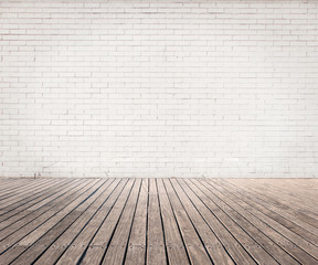white bricks wall and wood floor