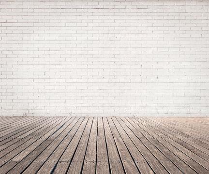 white bricks wall and wood floor
