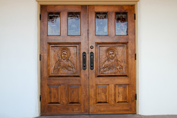 Hand-carved Jesus on wooden church doors