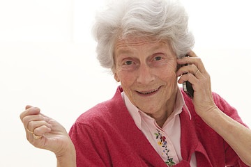 Happy senior woman conversing on the phone