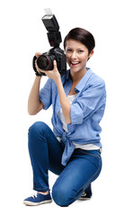 Woman-photographer takes snaps, isolated on white