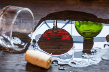 the still life with Wine glass on a wooden background