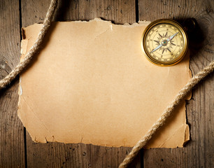 Fototapete - Old compass and rope on old paper.