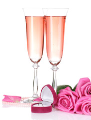Composition with pink sparkle wine in glasses, and pink roses