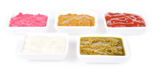 Various sauces isolated on white