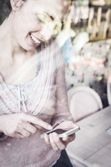 Smiling young woman using smartphone
