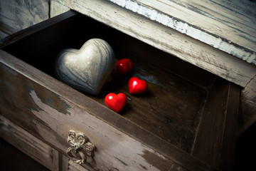 Hearts made ​​of stone and wood in a drawer, valentine day