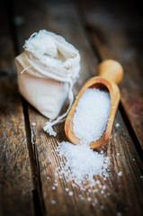 Closeup of sea salt on rustic wooden background