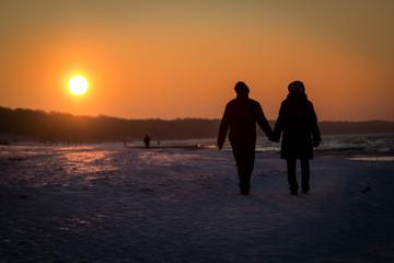 Loving couple at sunset background