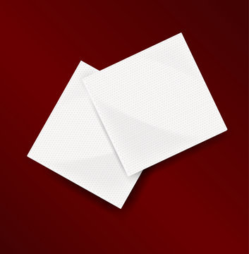 two napkins on a dark red background