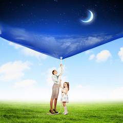 Family pulling banner