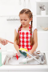 Do the dishes this instant - child ordered to wash up tableware