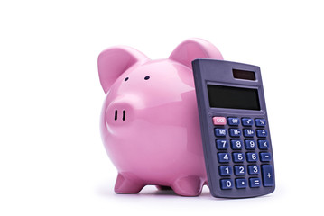 Pink piggy bank with a calculator