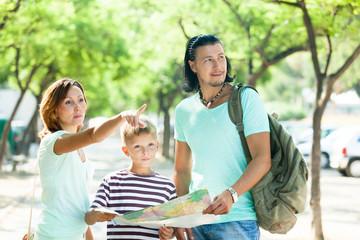 Family searching way at map